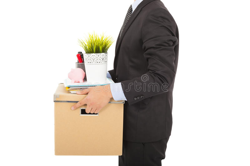 Fired businessman carrying his belongings royalty free stock photography