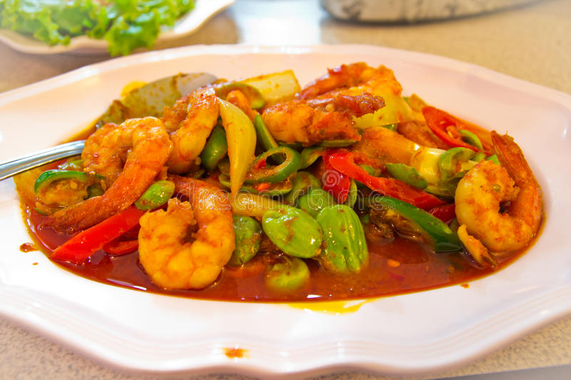 The fired curry shrimp thai food. The fired curry shrimp with vegetables , thai food stock images