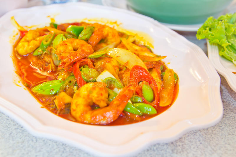 The fired curry shrimp thai food. The fired curry shrimp with vegetables , thailand food stock photography