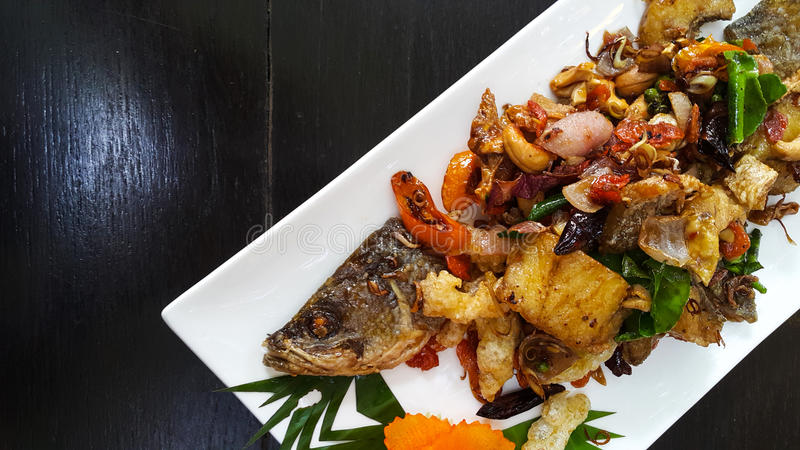 Fired fish with fishsauce delicious thai food. stock images