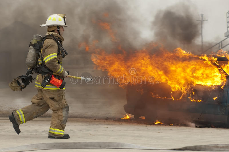 Firefighter in action royalty free stock photo