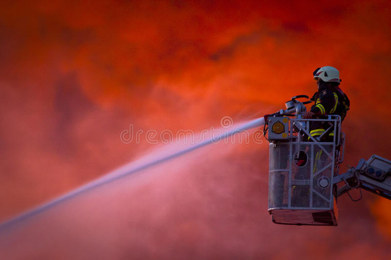 Firefighter in action stock photos