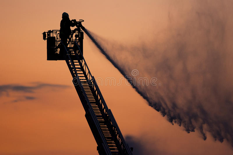 Firefighter in action royalty free stock images