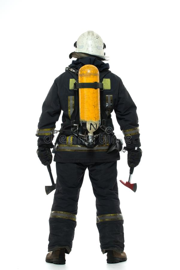 Firefighter with axe and oxygen balloon stock image