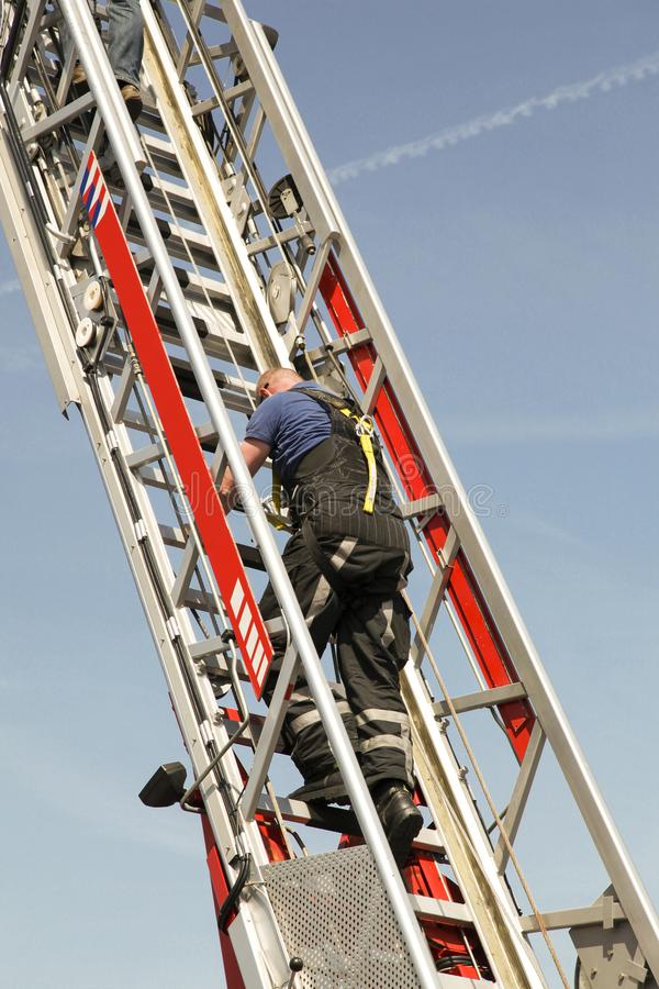 Firefighter Climbing An Aerial Ladder Stock Image Image