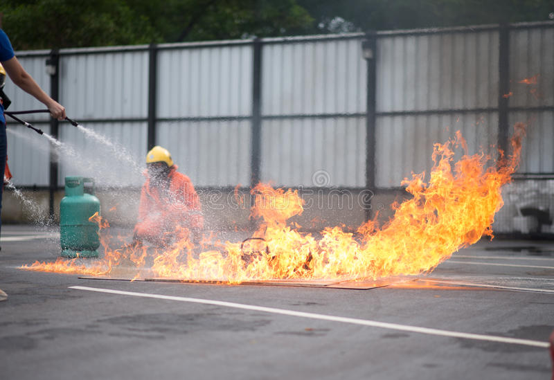 Firefighter fighting fire during training stock image