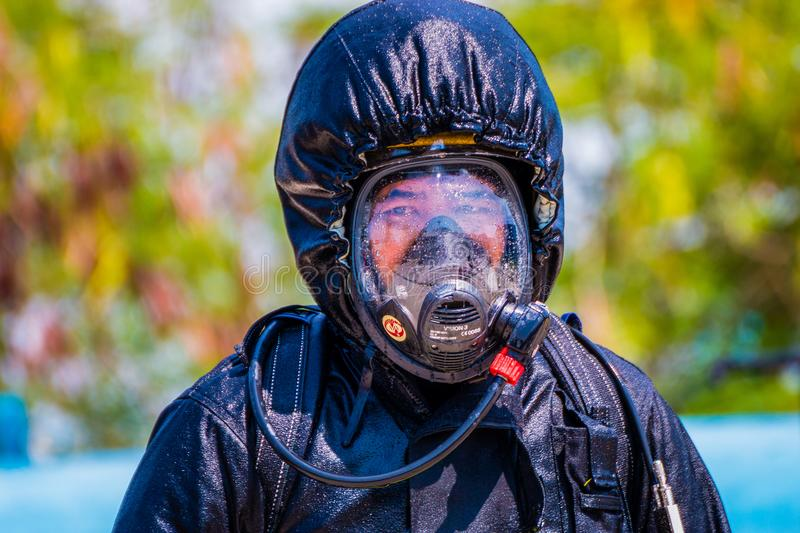 Firefighter fighting fire during training royalty free stock photography