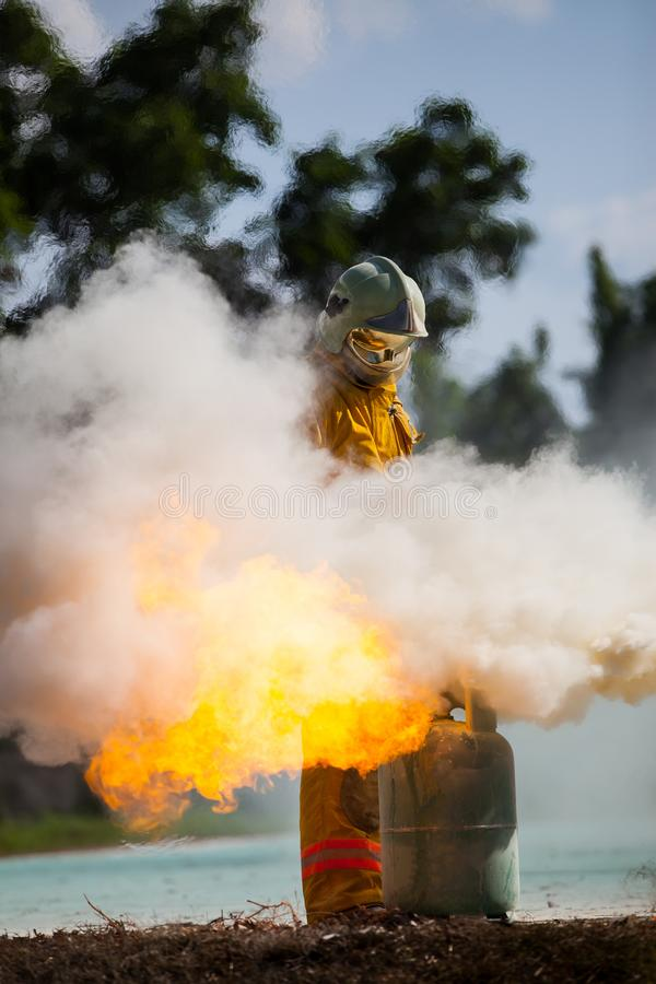 Firefighter with fire and suit for protect fire fighter. stock images