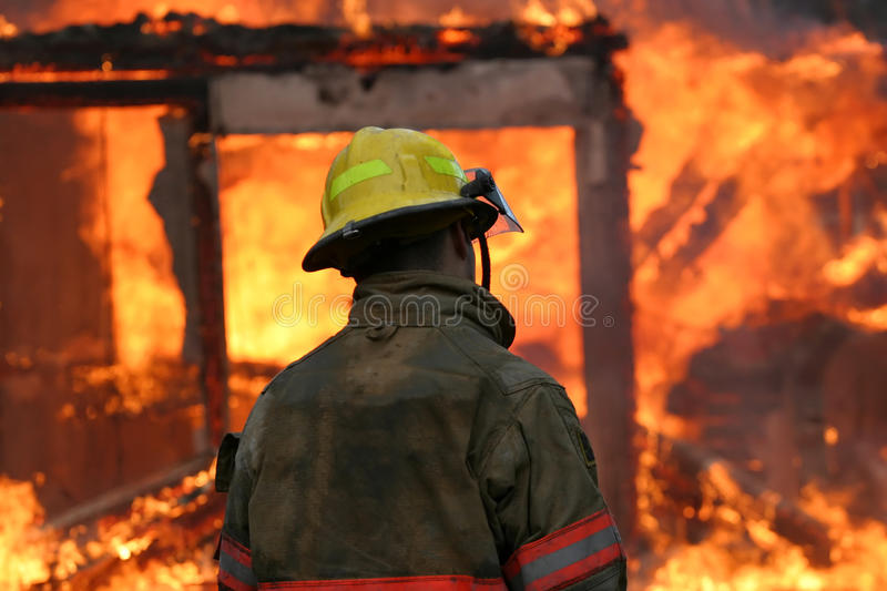 Download Firefighter in Flames stock photo. Image of emergency - 18245360