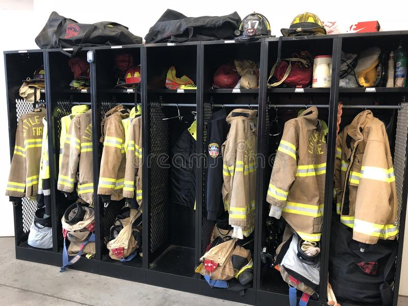 Firefighter gear before the alarm. Volunteer and paid fire departments enforce safety standards for all members of a fire station team. This includes use of stock images