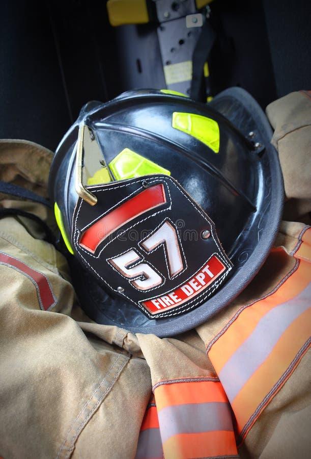 Download Firefighter Hat Helmet On Jacket Stock Image - Image of courage, department: 27170373