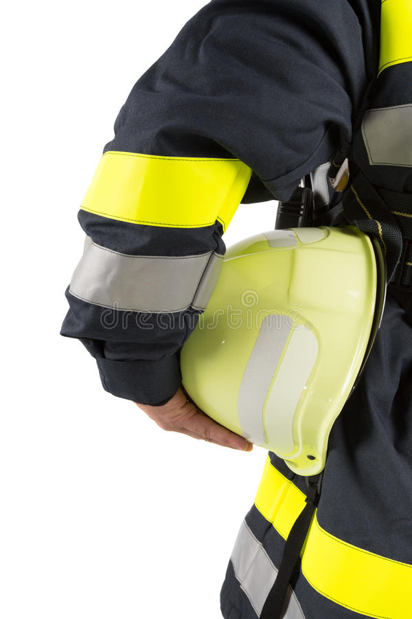 Firefighter holding helmet isolated on white stock photo