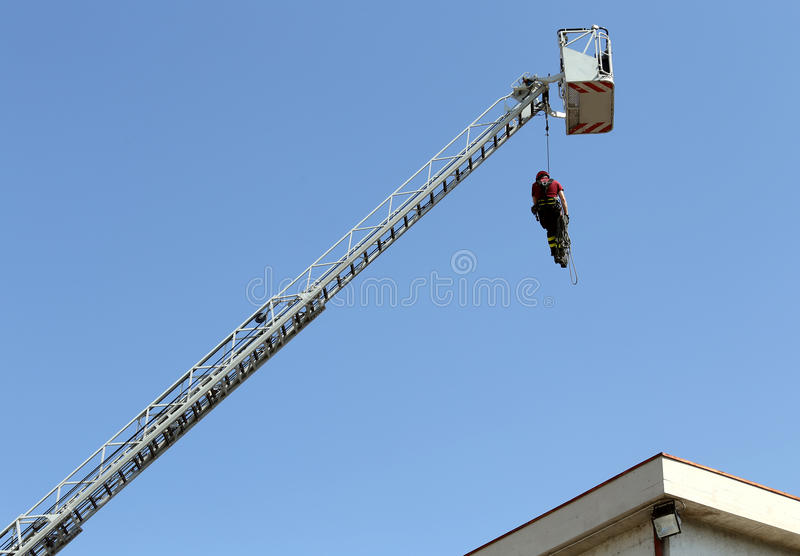 Firefighter hung the rope climbing during the practical exercise stock photos