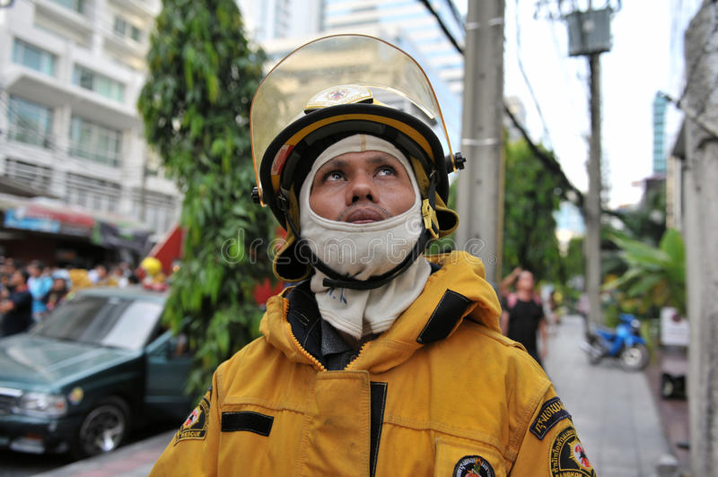 Download A Firefighter Looks On At Blaze In An Office Block Editorial Photography - Image: 23753127