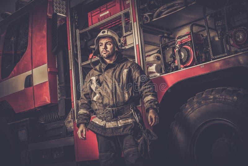 Firefighter near truck stock images