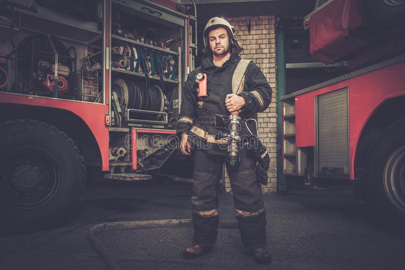 Firefighter near truck with equipment royalty free stock photo