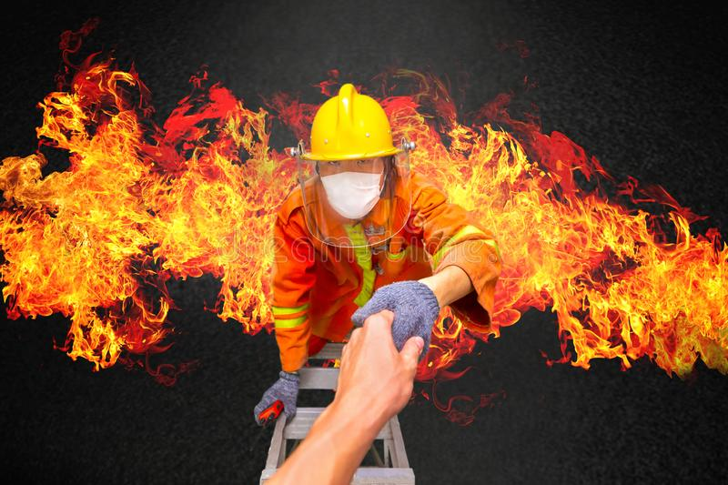 Firefighter rescue, fireman climbing on fire stairs or turntable. Ladder from burning building and holding hand to save people in fire and smoke from incident royalty free stock images