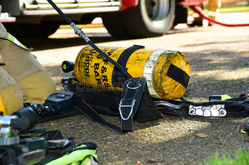 Firefighter's breathing apparatus at an incident. Firefighter's breathing apparatus is prepared at the scene of a fire. EDITORIAL IMAGE royalty free stock photo