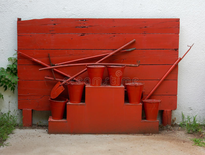 Firefighter shield. With buckets, shovels, gaff royalty free stock image