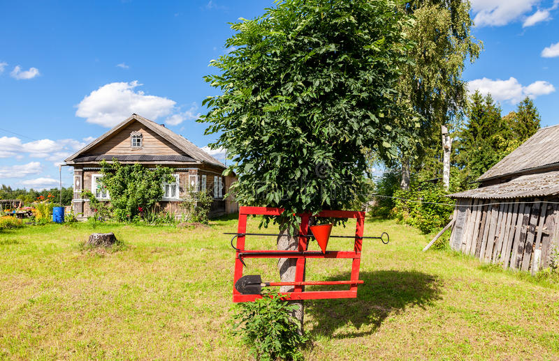 Firefighter shield with fire extinguishing tools. In Russian village stock photos