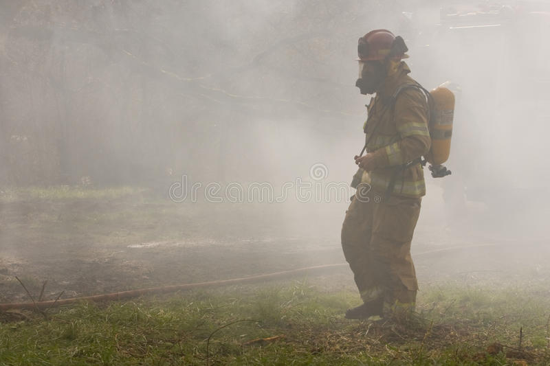 Download Firefighter in Smoke stock image. Image of firefighter - 18059741