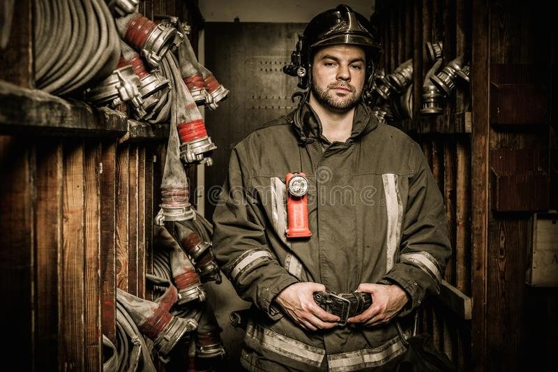 Firefighter in storage room royalty free stock photos