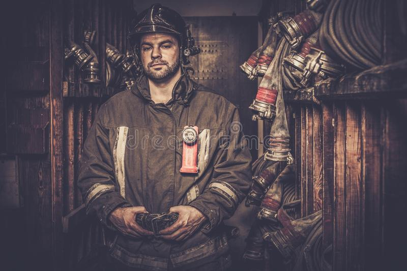 Firefighter in storage room stock images