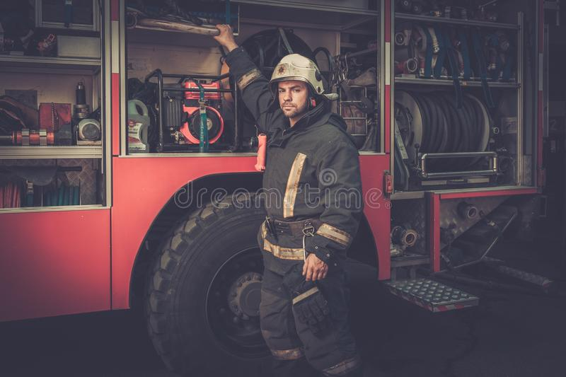 Firefighter in storage room stock photos