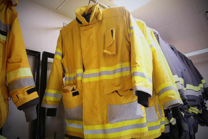 Firefighter suit and equipment ready for operation, Fire fighter room for store equipment, Protection equipment of fire fighter.  stock photo
