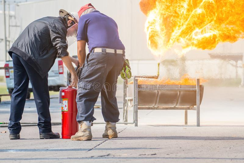 Firefighter training, The Employees Annual training Fire fighting with gas and flame royalty free stock photo