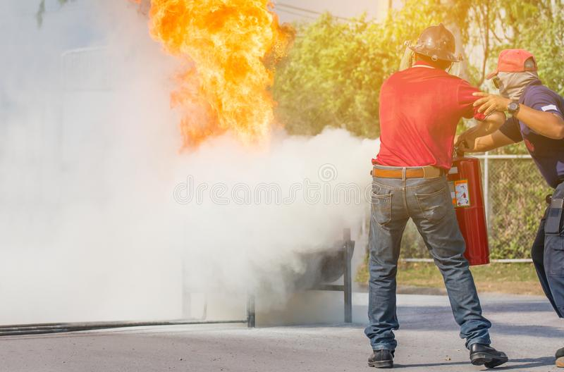 Firefighter training,Instructor training how to use a fire extinguisher for fighting fire royalty free stock photography