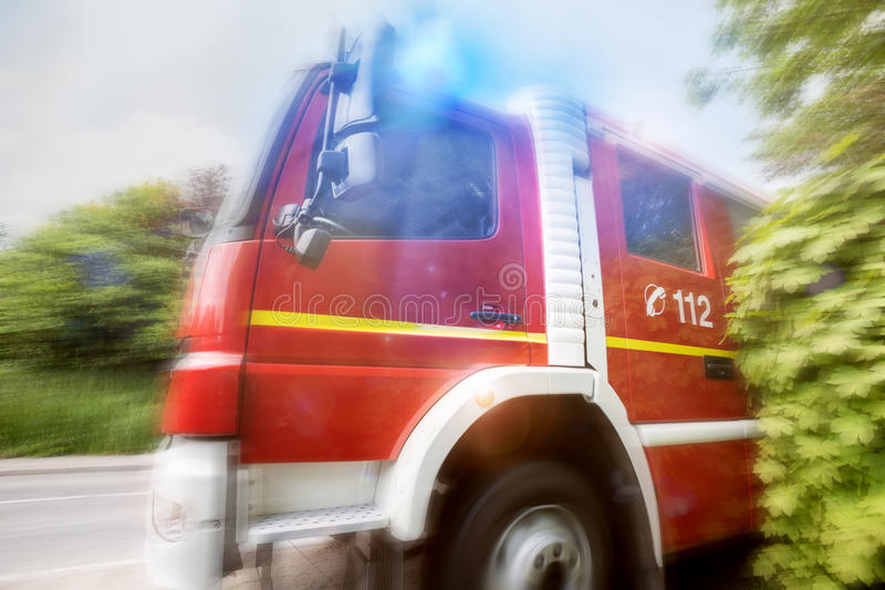 Firefighter truck speed composing royalty free stock images