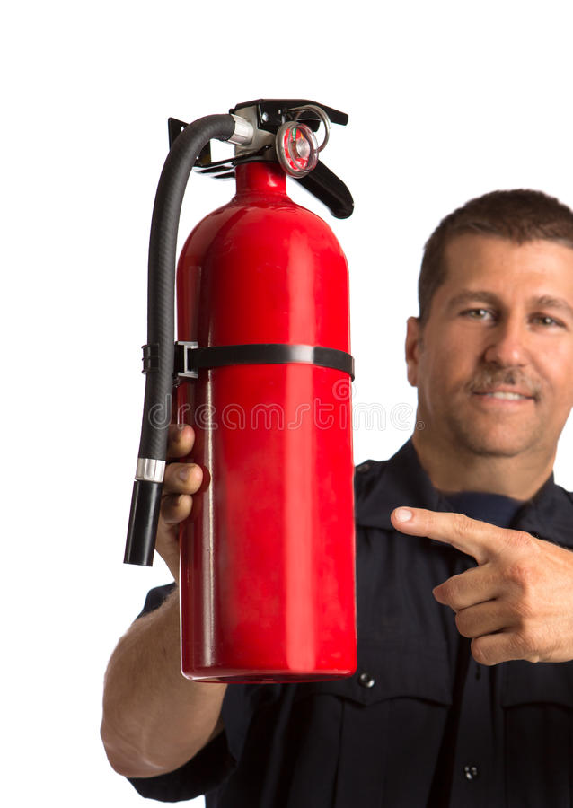 Download Firefighter In Uniform Holding Fire Extinguisher Stock Image - Image: 27113953