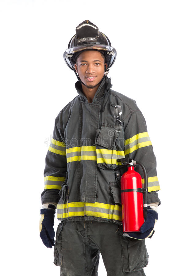Firefighter In Uniform Holding Fire Extinguisher Stock