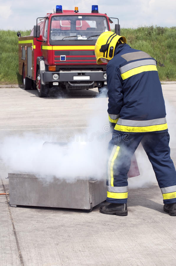 Firefighter Using Extinguisher Royalty Free Stock Photography
