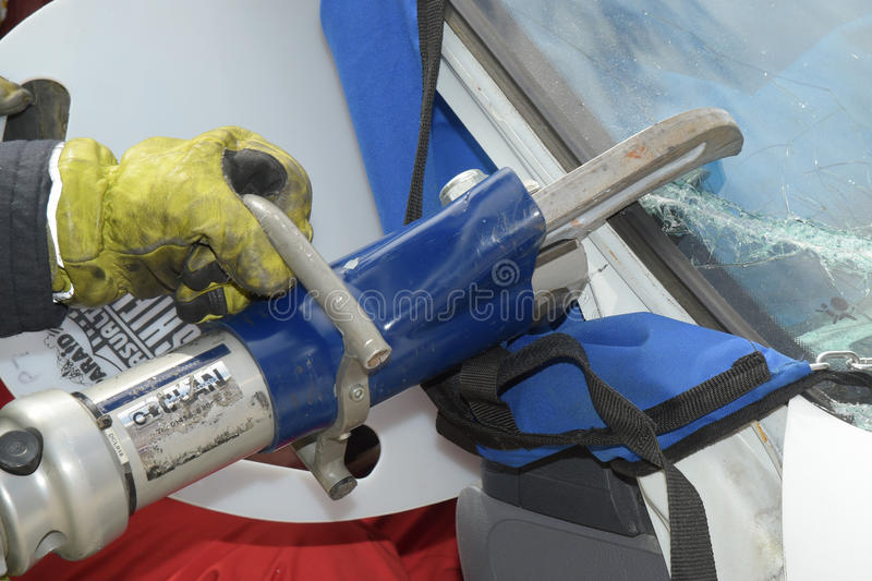 Firefighter using jaws of life royalty free stock photos