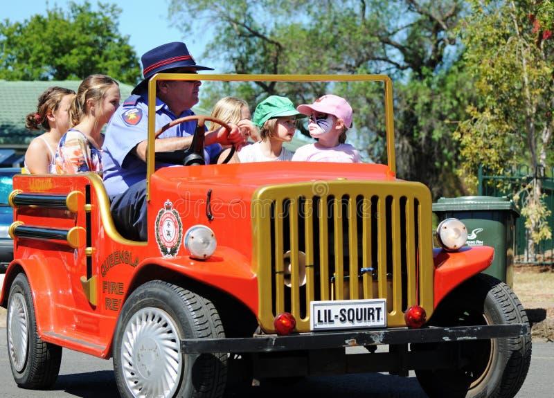 Firefighter volunteer in mini truck teaching children bushfires & wildlife rescue royalty free stock image