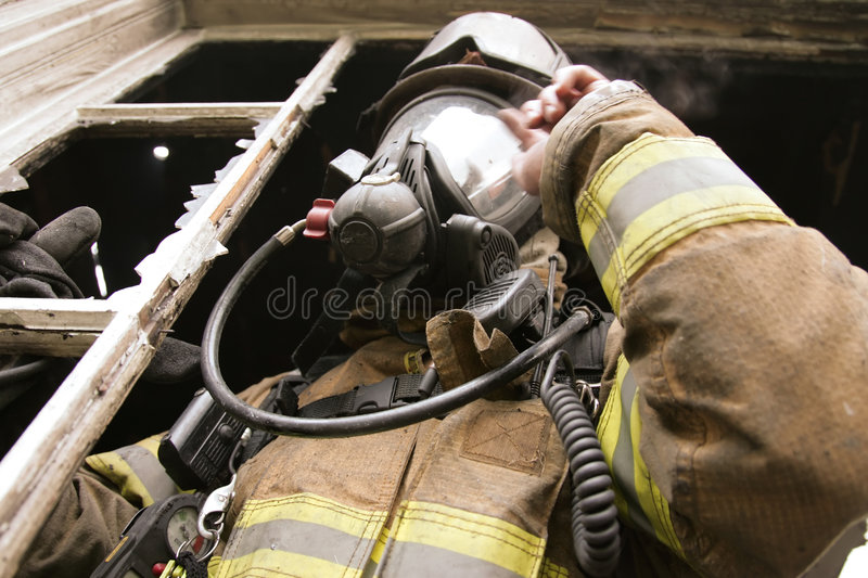 Download Firefighter at window stock photo. Image of disasters - 2595260