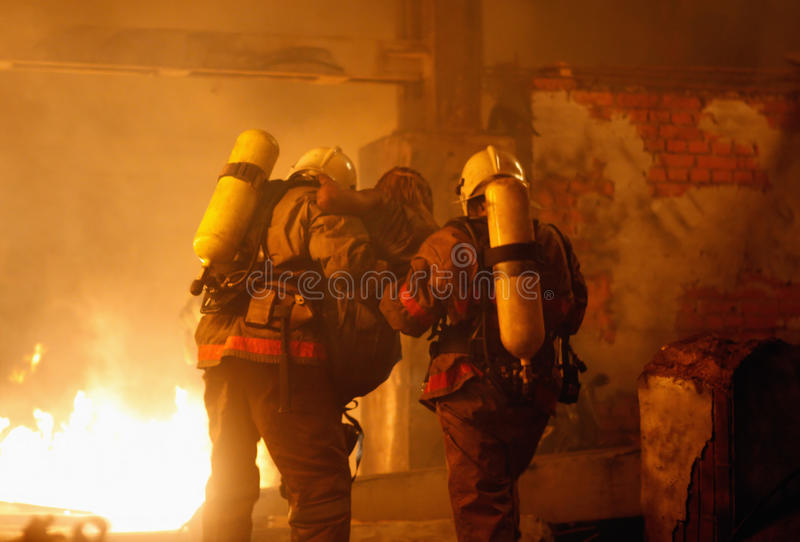 Firefighters with accident victim stock images