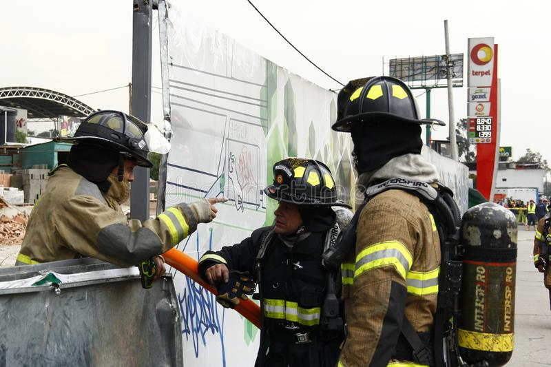 Firefighters in action against fire stock photography