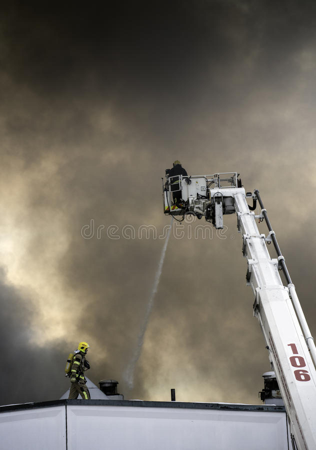 Firefighters in action stock images
