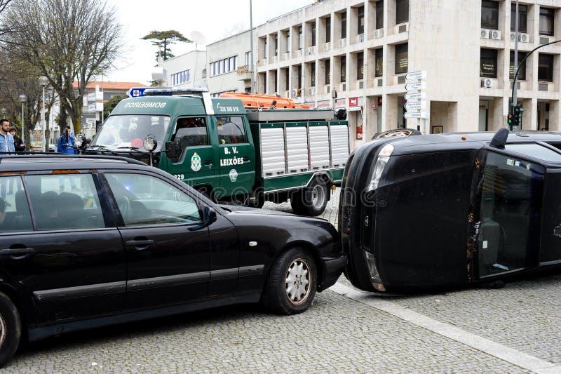 Firefighters arrive to a car overturned crash scene. stock images