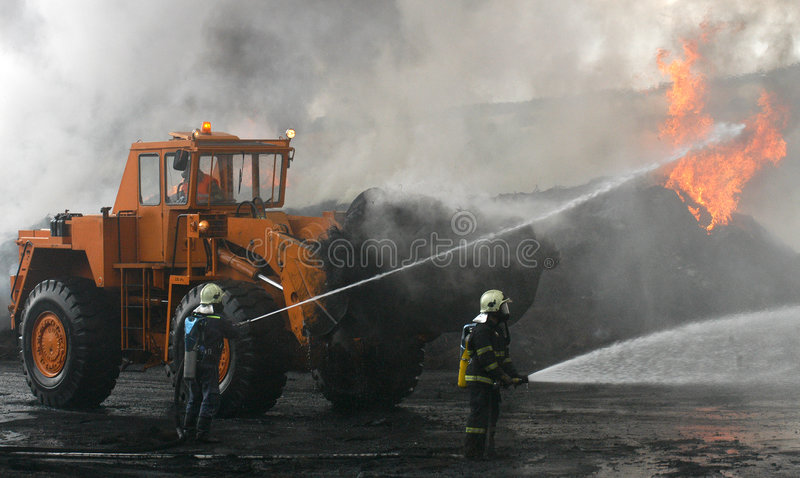 Firefighters at blaze stock photos