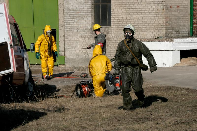 Firefighters in chemical protection suit. During the job royalty free stock image