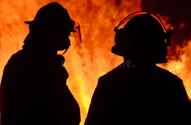Firefighters on duty at wildfire wild forest fire out of control in night stock image