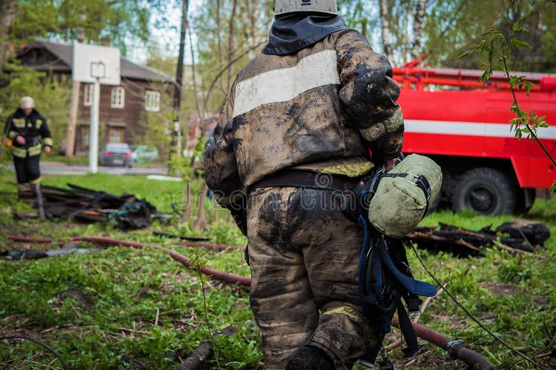 Firefighters extinguish the fire stock image