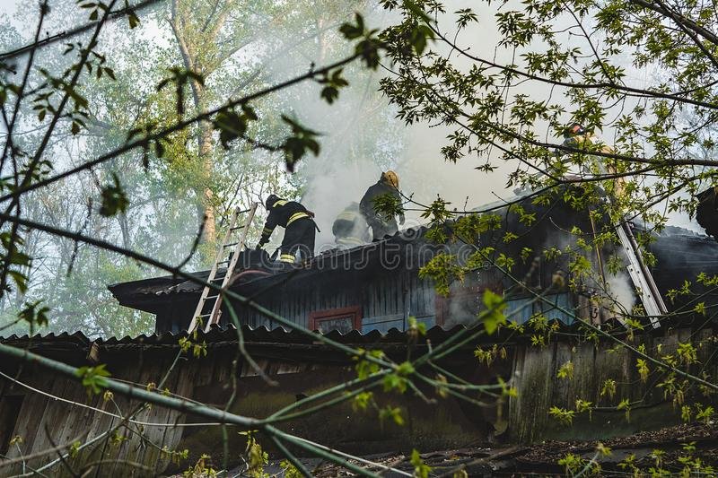 Firefighters extinguish the fire royalty free stock photo
