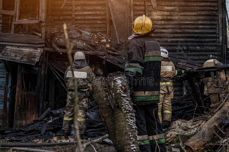 Firefighters extinguish the fire stock photos