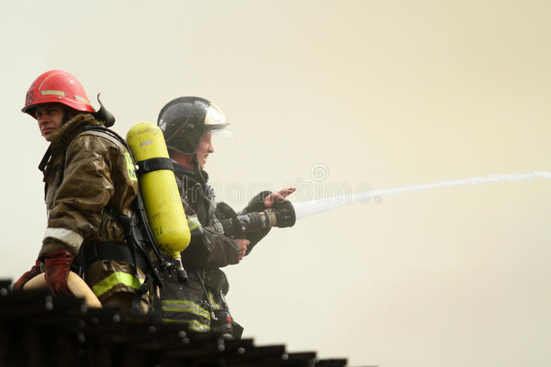 Firefighters extinguishes a burning restaurant royalty free stock image
