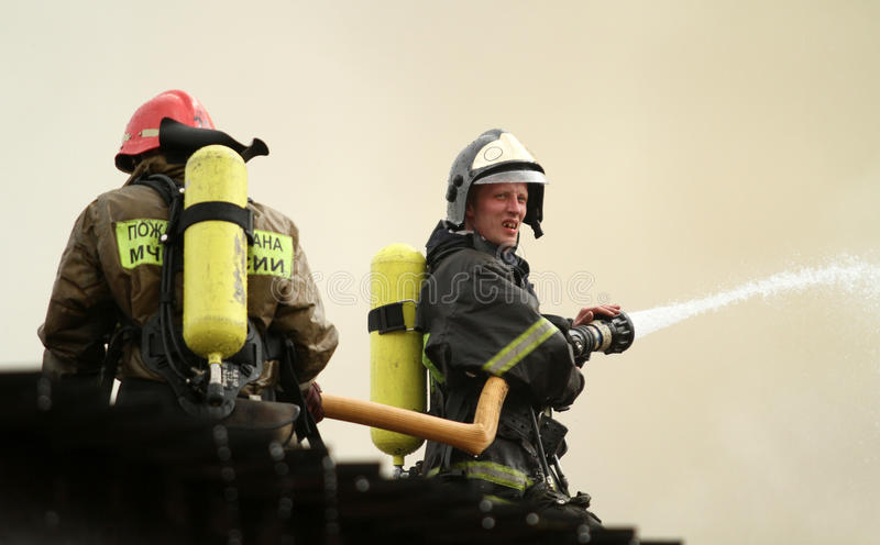 Download Firefighters Extinguishing Fire Editorial Stock Photo - Image: 14838838